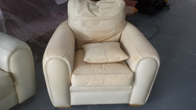 Armchair of suite badly sun faded