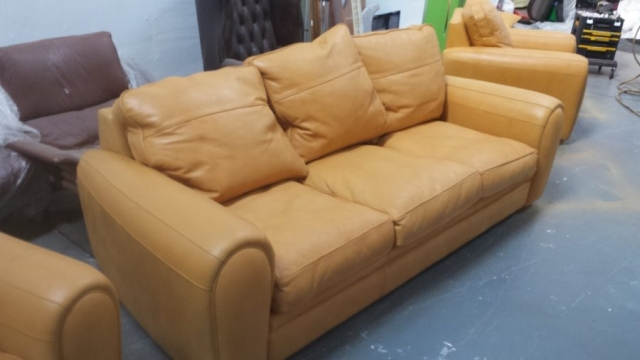 3 seat sofa of suite badly sun faded now restored