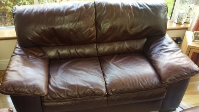Brown leather sofa with colour aging