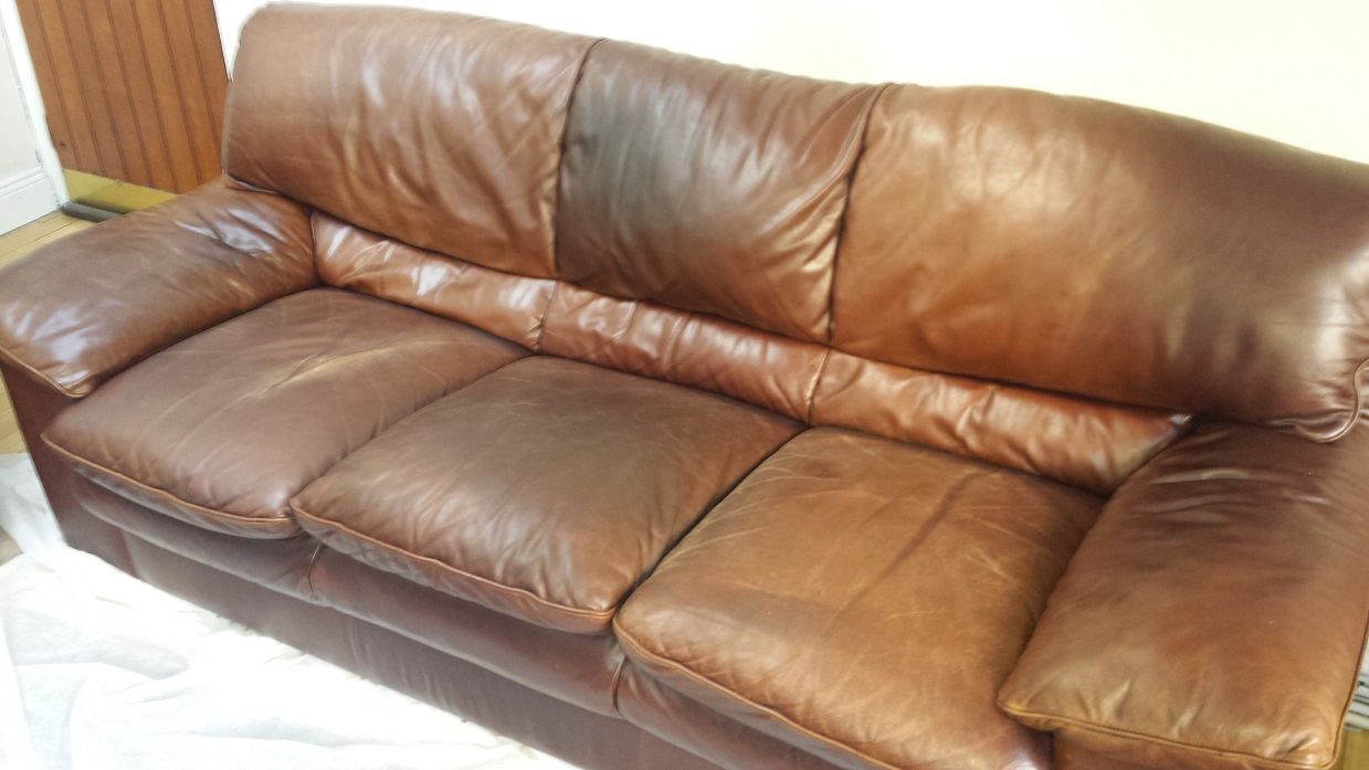 Brown leather sofa with colour fading