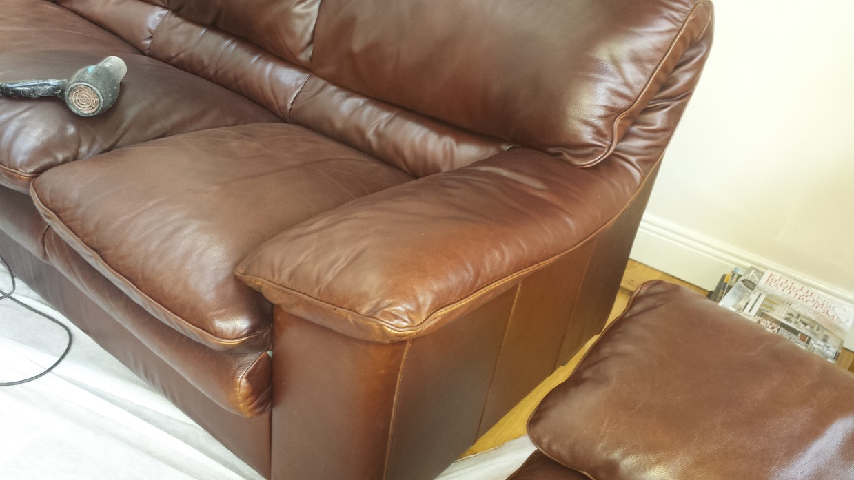 Brown leather sofa arm with colour fading