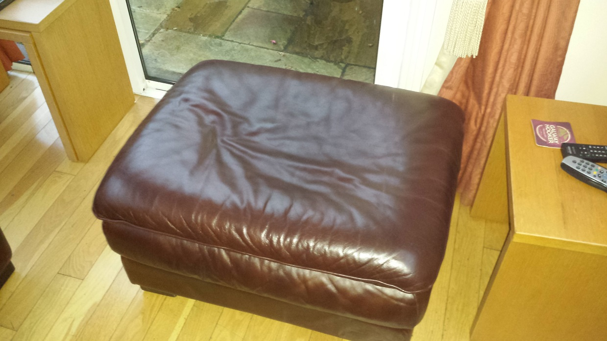 Stained and aged leather footrest cleaned and colour restored