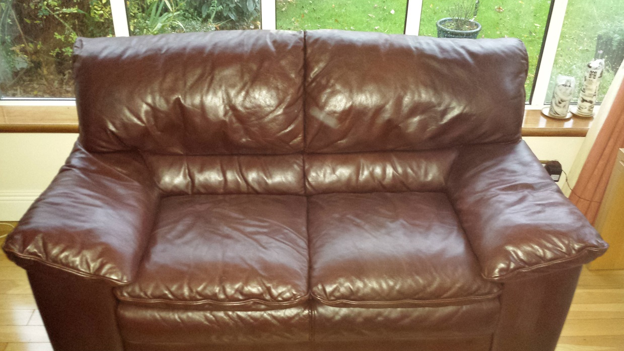 Brown leather sofa with colour aging renewed