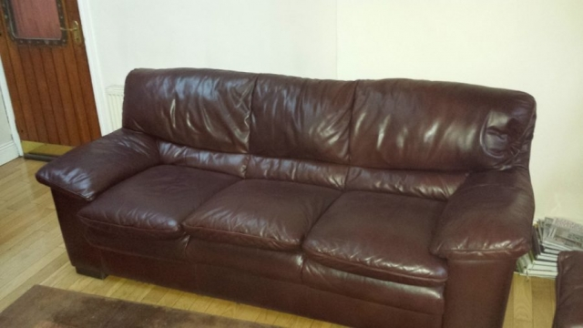 Brown leather sofa with colour fading back to like new