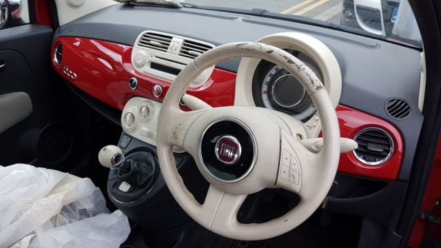 Fiat worn white steering wheel